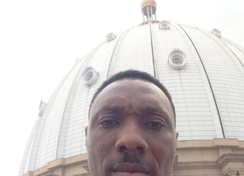 Toyin takes a selfie in front of the largest cathedral in the world!
